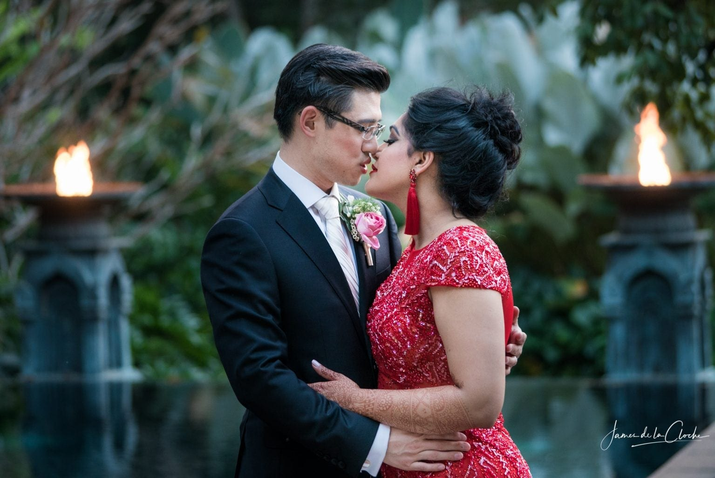 Bride and Groom Kiss at Dusk