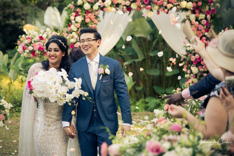 Bride and Groom Walk Through Rose Petals