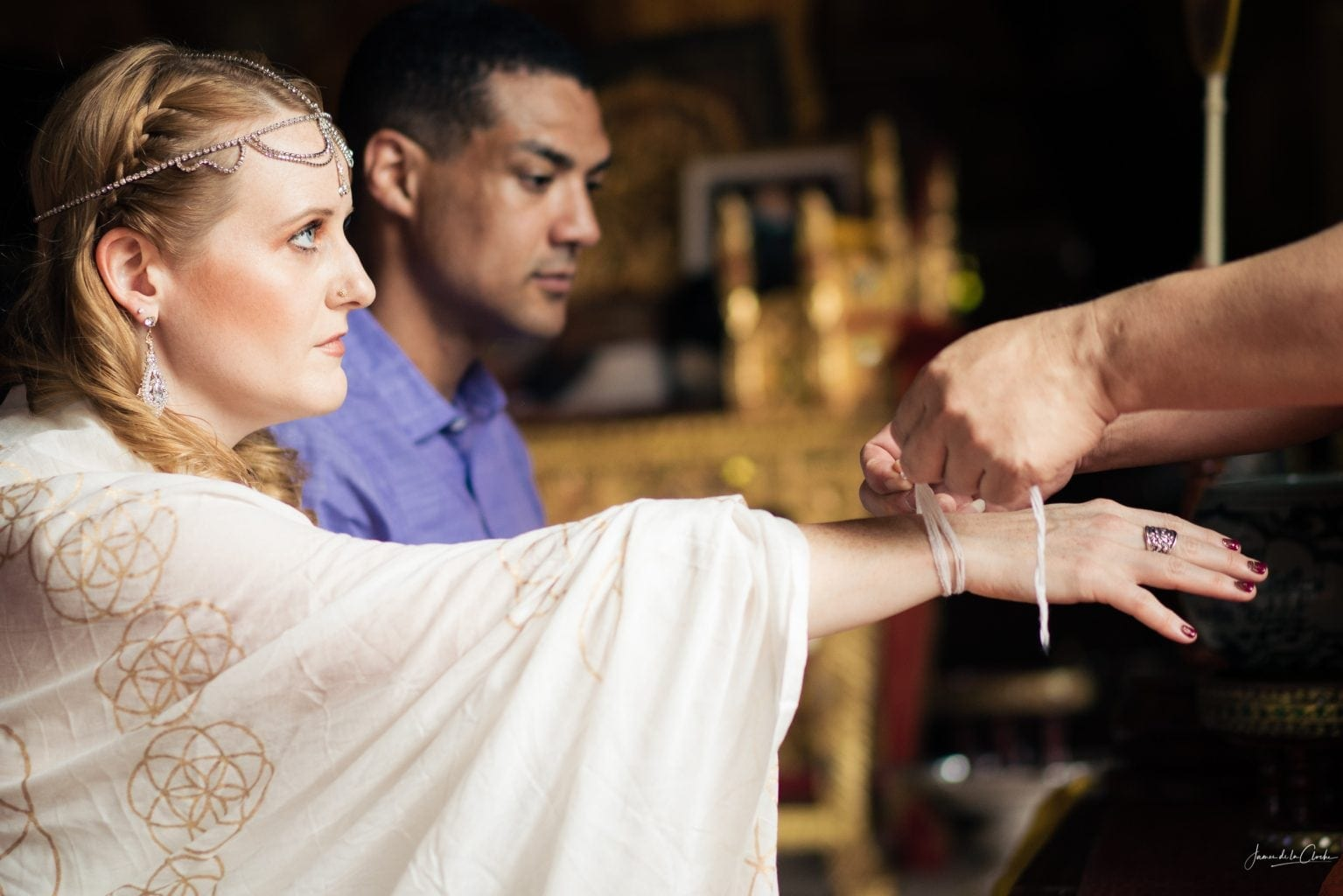 string tied on the bride's wrist